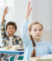 children-raising-hands-in-school.jpg